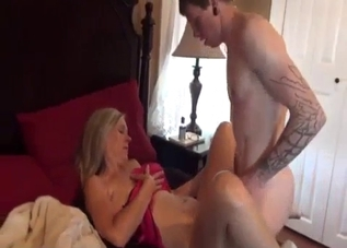 Red get-up blonde fucking her sons on a bed