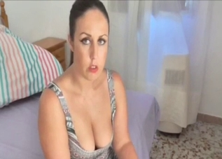 Ponytailed MILF fingering her pussy on a bed
