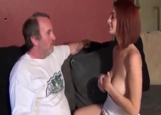 Skirt-wearing redhead spanked by her dad