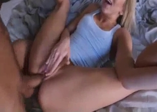 Top-wearing blonde fucking her relative on a bed