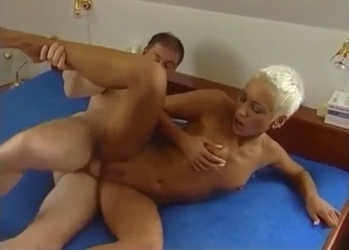 Tanned blonde with a buzzcut bangs her brother