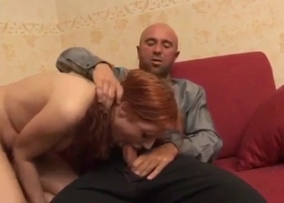 Pigtailed redhead sucking daddy's cock