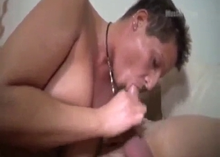 Fat short-haired MILF fucks her scared-looking son