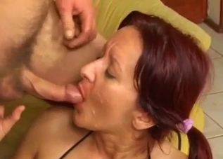 Long-legged redhead takes her son's cock
