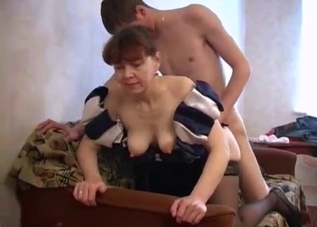 Redhead with saggy tits fucks her hung son