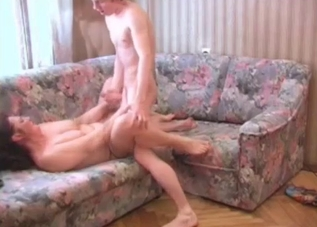 Dark-haired mommy fucks her energetic son