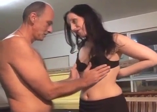 Brunette in purple sucking her father's cock