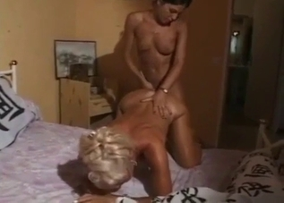 Tanned mom and daughter eating each other's pussies on a bed